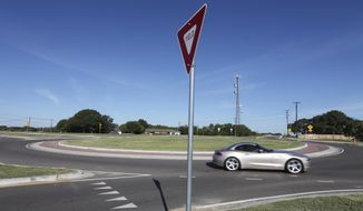ADVANCE FOR SUNDAY OCT. 9 AND THEREAFTER - In a Friday, Sept. 30, 2016 photo, motorisst make their way around the recently completed traffic circle, in Waco, Texas. Transportation officials say modern traffic circles are becoming more common in new construction because they can reduce wrecks and lower maintenance cost. (Rod Aydelotte/Waco Tribune-Herald via AP)