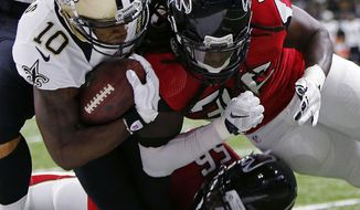 FILE - In this Sept. 26, 2016, file photo, New Orleans Saints wide receiver Brandin Cooks (10) gets near the goal line as he is tackled by Atlanta Falcons linebacker Sean Weatherspoon (56) and strong safety Kemal Ishmael (36) in the first half of an NFL football game in New Orleans. After losing Weatherspoon to IR with an Achilles injury, playing last week without De'Vondre Campbell and Paul Worrilow and then seeing Deion Jones suffer a calf injury, the Falcons are facing a severe shortage of linebackers as they prepare to face the Denver Broncos. (AP Photo/Butch Dill, File)