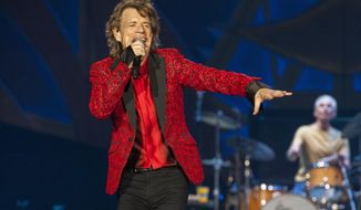 FILE - In this July 4, 2015 file photo, Mick Jagger of the Rolling Stones performs at the Indianapolis Motor Speedway in Indianapolis, Ind. The Rolling Stones will perform at the Desert Trip music festival, kicking off Friday, Oct. 7, in Indio, Calif. (Photo by Barry Brecheisen/Invision/AP, File)