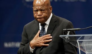 """FILE - In this Sept. 19, 2016 file photo, Rep. John Lewis, D-Ga., reacts after being presented with the Liberty Medal for his dedication to civil rights during a ceremony in Philadelphia. Novels by Colson Whitehead and Jacqueline Woodson and a graphic novel by Lewis are among the finalists announced Thursday, Oct. 6, for the National Book Award. Lewis, the longtime Georgia congressman, is in the young people's literature category for """"March: Book Three,"""" the last of a trilogy based on his years in the civil rights movement. (AP Photo/Matt Slocum, File)"""