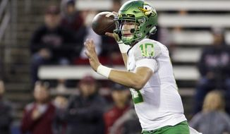 FILE - In this Oct. 1, 2016, file photo, Oregon quarterback Justin Herbert passes the ball during the second half of an NCAA college football game against Washington State in Pullman, Wash. Herbert has appeared in two games, competing three of five passes for 70 yards. (AP Photo/Young Kwak, File)