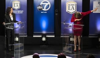 """In this Wednesday, Oct. 5, 2016 photo, Rep. Loretta Sanchez, D-Orange, right, does the """"dab"""" at the conclusion of her debate with state Attorney General Kamala Harris in Los Angeles. The Orange County congresswoman capped the hour-long event with her fellow Democrat by mimicking a celebratory gesture popularized by NFL star Cam Newton. (Ed Crisostomo/The Orange County Register via AP)"""