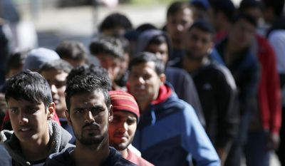 Migrants queue for food at a park where hundreds of migrants are temporarily residing in Belgrade, Serbia, Thursday, Oct. 6, 2016. Thousands of young Afghan men remain in Serbia looking for ways to reach wealthy EU nations, despite closed borders and reports that their government in Kabul has agreed to cooperate on the return of its citizens that have been rejected for asylum. (AP Photo/Darko Vojinovic)