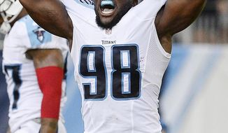 FILE - In this Aug. 20, 2016, file photo, Tennessee Titans outside linebacker Brian Orakpo celebrates his tackle of Carolina Panthers quarterback Cam Newton in the first half of an NFL preseason football game in Nashville, Tenn. Orakpo is averaging a sack a game so far and has four of the Titans' six sacks as they prepare to play Miami on Sunday, Oct. 9, 2016. (AP Photo/Mark Zaleski, File)