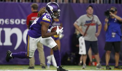 FILE - In this Sept. 18, 2016, file photo, Minnesota Vikings wide receiver Cordarrelle Patterson returns a kickoff during the first half of an NFL football game against the Green Bay Packers, in Minneapolis. Patterson might never be an every-down wide receiver in the NFL, but this former first-round draft pick, in the final year of his rookie contract with Minnesota, has embraced his alternative roles and been an important contributor to the undefeated Vikings.(AP Photo/Andy Clayton-King, File)