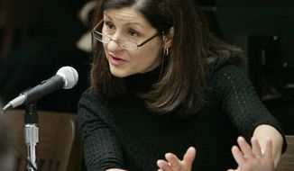 FILE - In this May 18, 2007, file photo, Christiane Ayotte, director of the Montreal WADA accredited laboratory, testifies during an arbitration hearing on the doping allegations against 2006 Tour de France champion Floyd Landis at Pepperdine University in Malibu, Calif. Ayotte, the director of the WADA-accredited anti-doping laboratory in Montreal, tells The Associated Press she is wary of the anti-doping summit the International Olympic Committee is holding Saturday, Oct. 8, 2016. (AP Photo/Reed Saxon, File)