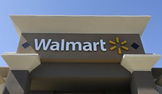 FILE - This Sept. 19, 2013, file photo, shows the sign of a Wal-Mart store in San Jose, Calif. Wal-Mart said Thursday, Oct. 6, 2016, it plans to slow new store openings as it looks to pour more money into its online efforts, technology and store remodels. (AP Photo/Jeff Chiu, File)