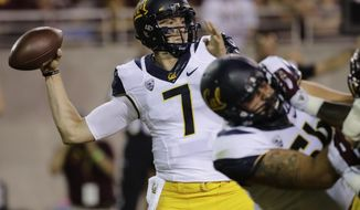 FILE - In this Sept. 24, 2016, file photo, California quarterback Davis Webb throws against Arizona State during an NCAA college football game in Tempe, Ariz. Boosted by a pair of wins over ranked teams this season, including last weekend's dramatic victory over Utah, the California Golden Bears are trying to stay vigilant in their game against Oregon State in Corvallis, Ore., Saturday, Oct. 8. (AP Photo/Matt York, file)