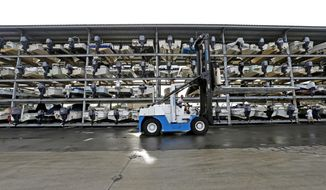 Boats are safely stored at Atlantic Marine in Wrightsville Beach, N.C., Friday, Oct. 7, 2016, as Hurricane Matthew moves up the southeast coast. (AP Photo/Gerry Broome)