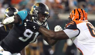 FILE - In this Aug. 28, 2016, file photo, Jacksonville Jaguars defensive end Yannick Ngakoue (91) goes head to head with Cincinnati Bengals guard Trey Hopkins during the first half half of an NFL preseason football game in Jacksonville, Fla. Rookie Ngakoue is having as big an impact as any of them for the Jaguars this season. (AP Photo/Stephen B. Morton, File)