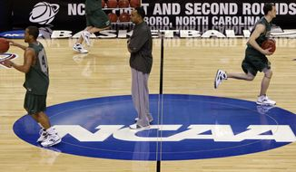 FILE - In this March 18, 2009, file photo, Binghamton coach Kevin Broadus, center, looks on during a basketball practice for a first round NCAA college basketball game against Duke, in Greensboro, N.C. The NCAA relocated its men's basketball regional tournament to Greenville, South Carolina, on Friday, Oct. 7, 2016, after withdrawing the event from Greensboro, North Carolina, because of that state's law restricting the rights of LGBT people. (AP Photo/Steve Helber, File)