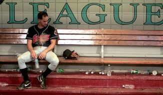 FILE - In this Oct. 27, 1997, file photo, Cleveland Indians shortstop Omar Vizquel sits dejectedly in the dugout after the Indians lost to the Marlins 3-2 in Game 7 of the baseball World Series at Pro Player Stadium in Miami.  (Roadell Hickman/The Cleveland Plain Dealer via AP, File)
