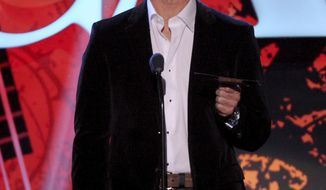 FILE - In this Dec. 10, 2013, file photo, Joe Buck speaks on stage at the American Country Awards at the Mandalay Bay Resort & Casino in Las Vegas. Sports Illustrated reported on Oct. 6, 2016, that in a new memoir, Buck writes that nerve damage he sustained during hair restoration surgery was responsible for a vocal cord injury he battled in 2011. (Photo by Frank Micelotta/Invision/AP, File)