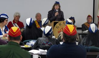 U.S. Senate candidate Margaret Stock, rear, addresses a gathering of the Alaska Native Brotherhood and Alaska Native Sisterhood in Juneau, Alaska, Friday, Oct. 7, 2016. Former U.S. Sen. Mark Begich, a Democrat, says he will support Stock, an independent. Two groups of Alaska Democrats also have expressed their backing of Stock over their own party nominee, Democrat Ray Metcalfe. (AP Photo/Becky Bohrer)