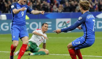 France's Kevin Gameiro, left, celebrates scoring his side's 4th goal with his teammate Antoine Griezman during a World Cup qualifying soccer match between France and Bulgaria at the Stade de France in Saint Denis, north of Paris, Friday, Oct. 7, 2016. (AP Photo/Michel Euler)