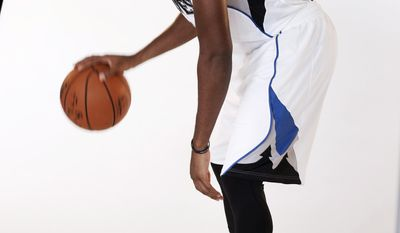 """In this Sept. 26, 2016 photo, Minnesota Timberwolves Kris Dunn poses for the team photographer during the NBA basketball teams media day in Minneapolis. A ripe old 22 years of age, Dunn is older than four of the team's high-profile """"veterans."""" The extra time in college has helped him transition to the NBA, and the fifth overall pick will make his debut in a preseason game on Saturday. (AP Photo/Jim Mone)"""