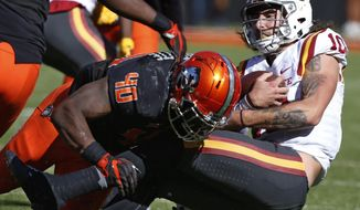 Iowa State quarterback Jacob Park (10) is tackled by Oklahoma State linebacker Devante Averette (40) in the second quarter of an NCAA college football game in Stillwater, Okla., Saturday, Oct. 8, 2016. (AP Photo/Sue Ogrocki)