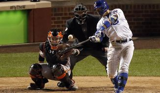 Chicago Cubs' Javier Baez (9) hits a home run in the eighth inning of Game 1 of baseball's National League Division Series against the San Francisco Giants, Friday, Oct. 7, 2016, in Chicago. (AP Photo/Charles Rex Arbogast)