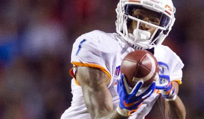 Boise State wide receiver Cedrick Wilson (1) makes a first-half reception against New Mexico during an NCAA ciollege football game Friday, Oct. 7, 2016, in Albuquerque, N.M. (Darin Oswald/Idaho Statesman via AP)
