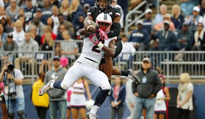 Connecticut wide receiver Tyraiq Beals has a pass broken up by Cincinnati cornerback Linden Stephens during the second half of UConn's 20-9 win in an NCAA football game Saturday, Oct. 8, 2016, in East Hartford, Conn. (AP Photo/Winslow Townson)