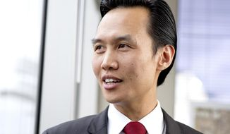 In this Jan. 5, 2016 photo Garden Grove, Calif., Mayor Bao Nguyen poses at City Hall. Nguyen is running against fellow Democrat former state Sen. Lou Correa for the 44th district seat left open by Loretta Sanchez' run for the Senate. (Leonard Ortiz  /The Orange County Register via AP)