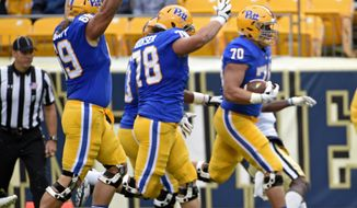 Pittsburgh's Adam Bisnowaty (69) and Alex Bookser (78) celebrate as offensive lineman Brian O'Neill (70) scores a touchdown during the first half of an NCAA college football game against Georgia Tech in Pittsburgh, Saturday, Oct. 8, 2016. (AP Photo/Fred Vuich)