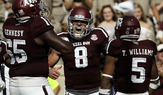 Texas A&M quarterback Trevor Knight (8) celebrates after rushing for a touchdown against the Tennessee during the first half of an NCAA college football game Saturday, Oct. 8, 2016, in College Station, Texas. (AP Photo/David J. Phillip)