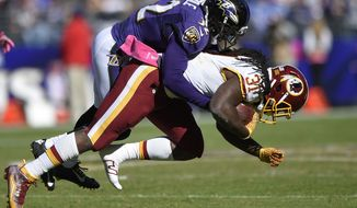 Baltimore Ravens' Eric Weddle (32) tackles Washington Redskins' Matt Jones (31) during the second half of an NFL football game, Sunday, Oct. 9, 2016, in Baltimore. (AP Photo/Nick Wass)