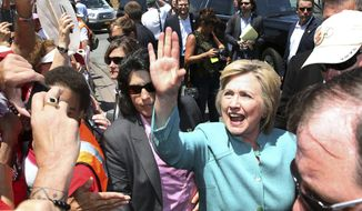FILE - In this July 6, 2016 file photo, Democratic presidential candidate Hillary Clinton greets striking workers outside the Trump Taj Mahal Casino and Hotel in Atlantic City, N.J. On Monday, Oct. 10, 2016, the last vestige of Donald Trump will vanish from Atlantic City when the Trump Taj Mahal casino shuts down. Trump, the Republican presidential nominee, tells The Associated Press that hes sad that the Taj Mahals new owner, his friend and fellow billionaire Carl Icahn, and the casino workers union couldnt reach a deal to keep the casino open.  (AP Photo/Mel Evans, File)