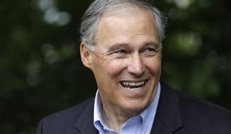 FILE -- In this Aug. 2, 2016, file photo, Democratic incumbent Gov. Jay Inslee prepares to speak at a news conference in Seattle. Washington voters have a long history of sending a Democrat to the governor's office. This year, they'll decide whether to continue that trend, unbroken since 1984, when they cast their vote between Inslee and his Republican challenger, Bill Bryant. (AP Photo/Elaine Thompson, File)