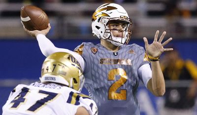 Arizona State's Brady White (2) gets off a pass as UCLA's Eddie Vanderdoes (47) applies pressure during the first half of an NCAA college football game Saturday, Oct. 8, 2016, in Tempe, Ariz. (AP Photo/Ross D. Franklin)