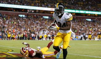Pittsburgh Steelers wide receiver Antonio Brown was hit with a penalty and $12,154 for twerking after scoring a touchdown against the Washington Redskins in Week 1. (Associated Press)