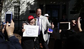 "Corey Stewart, chairman of Republican presidential candidate Donald Trump's Virginia campaign, right, gives the thumbs-up as he poses for a photo with Trump supporter Heidi Saba with her sign that reads ""Grandmothers Stand w/Trump!!!"" outside the Republican National Committee Headquarters in Washington, Monday, Oct. 10, 2016. Stewart and Virginia Women for Trump gathered in support of Trump.  (AP Photo/Carolyn Kaster)"