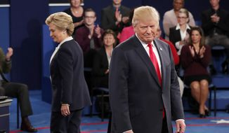 Democratic presidential nominee Hillary Clinton, left, and Republican presidential nominee Donald Trump arrive before the second presidential debate at Washington University in St. Louis, Sunday, Oct. 9, 2016. (Rick T. Wilking/Pool via AP)