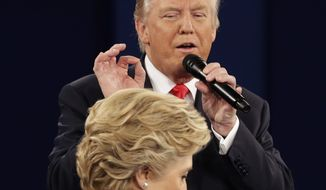 Republican presidential nominee Donald Trump lays out his case against Democratic presidential candidate Hillary Clinton during the second presidential debate Oct. 9 in St. Louis. (Associated Press)