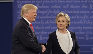 Republican presidential nominee Donald Trump shakes hands with Democratic presidential nominee Hillary Clinton during the second presidential debate at Washington University in St. Louis, Sunday, Oct. 9, 2016. (AP Photo/John Locher) ** FILE **