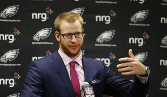 Philadelphia Eagles quarterback Carson Wentz addresses the media after an NFL football game against the Detroit Lions, Sunday, Oct. 9, 2016, in Detroit. (AP Photo/Rick Osentoski) **FILE**
