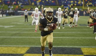 Navy running back Darryl Bonner (29) scores a touchdown during the second half of an NCAA football game against Houston, Saturday, Oct. 8, 2016, in Annapolis, Md. Navy won 46-40. (AP Photo/Nick Wass)