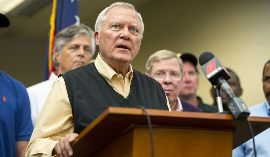 Georgia Governor Nathan Deal officially announces the end of his mandatory evacuation from Chatham County Sunday, Oct. 9, 2016, during a press conference at Signature Aviation. Residents were allowed back to their home till the beginning of curfew at 10PM Sunday. (Josh Galemore/Savannah Morning News via AP)