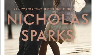 "This book cover image released by Grand Central Publishing shows ""Two By Two,"" a novel by Nicholas Sparks. (Grand Central Publishing via AP)"