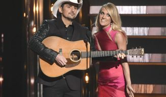 FILE - In this Nov. 4, 2015 file photo, hosts Brad Paisley, left, and Carrie Underwood speak at the 49th annual CMA Awards in Nashville, Tenn. Paisley and Underwood, along with Dierks Bentley, Eric Church, Maren Morris and Keith Urban will perform at the 50th annual Country Music Association Awards show on Nov. 2. (Photo by Chris Pizzello/Invision/AP, File)