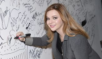 """In this April 14, 2015, file photo, actress Amber Tamblyn participates in AOL's BUILD Speaker Series to discuss herbook of poetry """"Dark Sparkler"""" at AOL Studios in New York. Tamblyn said in an Instagram post on Oct. 9, 2016, that the recently discovered crude remarks about women Donald Trump made in 2005 prompted Tamblyn to discuss what she describes an assault by a former boyfriend. (Photo by Evan Agostini/Invision/AP, File)"""