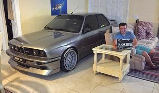 Car enthusiast Randy Jalil became a social media sensation after sharing photos of himself parking his BMW in the living room of his Port Saint Lucie, Florida, home in anticipation of Hurricane Matthew. (Instagram)