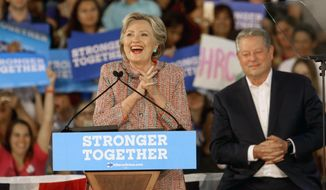 Democratic presidential candidate Hillary Clinton, is joined at a rally with former Vice President Al Gore at Miami Dade College in Miami, Tuesday, Oct. 11, 2016. (Mike Stocker/South Florida Sun-Sentinel via AP) **FILE**