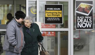 In this Tuesday, Nov. 25, 2014, file photo, a man and a woman leave an Hhgregg store in Mayfield Heights, Ohio. On Oct. 12, CBL & Associates, a Tennesse shopping-mall management company, announced it was shutting its shopping centers, both open-air and enclosed, on Thanksgiving. (AP Photo/Tony Dejak, File) **FILE**