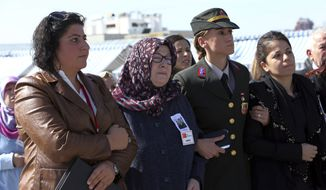 Mother, centre left, and some other family members attend a funeral ceremony for army officer Lt. Murat Taylan Oncel, 33, killed in a mortar attack Monday by Kurdish militants in Silvan, Diyarbakir, Turkey at the Kocatepe Mosque in Ankara, Tuesday, Oct. 11, 2016. Kurdish militants detonated a car bomb Sunday outside a military checkpoint in southeast Turkey, killing ten soldiers and eight civilians, Turkish Prime Minister Binali Yildirim said.(AP Photo/Burhan Ozbilici) ** FILE **