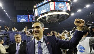 FILE - In this April 4, 2016, file photo, Villanova head coach Jay Wright celebrates after the NCAA Final Four tournament college basketball championship game against North Carolina, in Houston. Defending national champion Villanova is the runaway preseason No. 1 in the Big East Conference. (AP Photo/David J. Phillip, File)