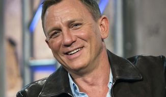 "FILE - In this Nov. 5, 2015 file photo, Daniel Craig participates in AOL's BUILD Speakers Series to discuss the James Bond film ""Spectre"", at AOL Studios in New York. Craig told the crowd Friday, Oct. 7, 2016, at the New Yorker Festival that playing 007 is ""the best job in the world."" He said that if he were to stop playing the role, he ""would miss it terribly."" (Photo by Charles Sykes/Invision/AP, File)"