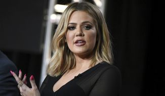 """FILE - In this Jan. 6, 2016, file photo, Khloe Kardashian participates in the panel for """"Kocktails with Khloe"""" at the FYI 2016 Winter TCA in Pasadena, Calif. Kardashian said on the """"Ellen DeGeneres Show"""" in an interview broadcast on Tue., Oct. 11, 2016, that her older sister, Kim Kardashian West, is """"not doing that well"""" more than a week after being held up during a Paris jewelry heist. (Photo by Richard Shotwell/Invision/AP, File)"""
