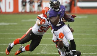 FILE - In this Sept. 18, 2016, file photo, Baltimore Ravens running back Justin Forsett (29) is tackled by Cleveland Browns strong safety Ibraheim Campbell, behind, and outside linebacker Joe Schobert (53) during an NFL football game in Cleveland. The Detroit Lions have signed Forsett to bolster their short-handed backfield. Forsett was released earlier this month by Baltimore after asking to be let go. He was on the inactive list two weekends ago and there didn't seem to be much playing time with the Ravens in his future. (AP Photo/Ron Schwane, File)